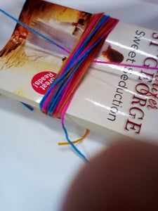 Get It Under the String in Front of the Book.