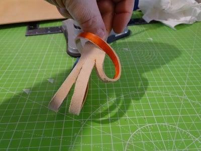 Braid Step 1:  Bottom Under the Right Hand Strip