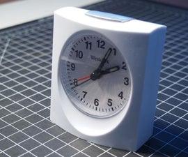 Quieting down a cheap alarm clock