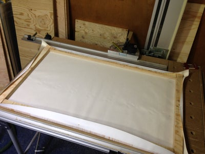 Staple or Attach the Canvas Graphic to the Back of the Frame.