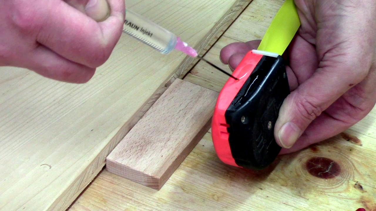 Picture of Glue the Tape Measure Onto the Board