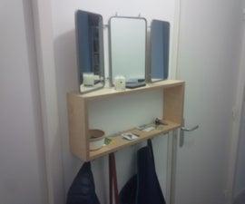 Entrance shelf with coat hanger