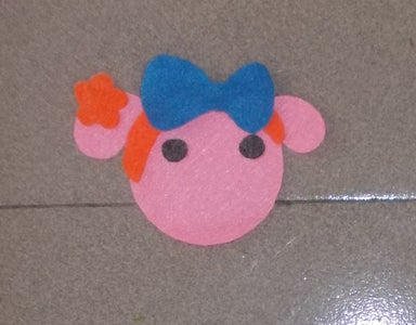 Cut Out the Blue Bow, Eyes and Glue Them Like the Picture.
