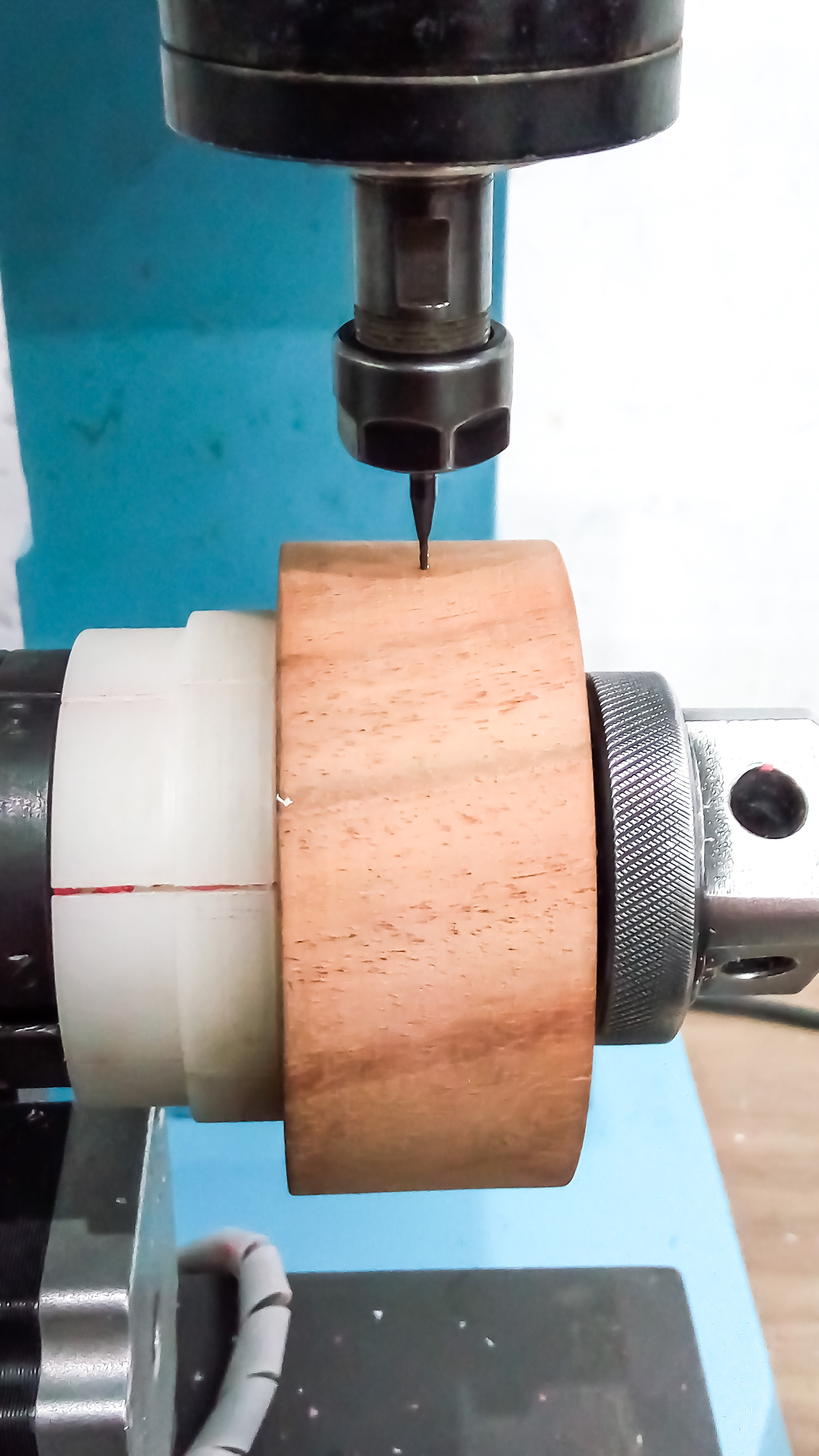 Picture of   Attaching the Work Piece to the CNC and Working