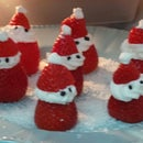 Decorated dessert - Santa Claus made ​​from strawberries and whipped cream