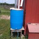 Rain barrel waterer using a float valve