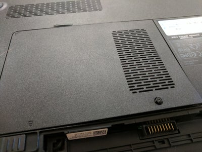 Place Panel on Top of Exposed RAM and Screw In