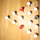 How to solve the Triangle Peg Game