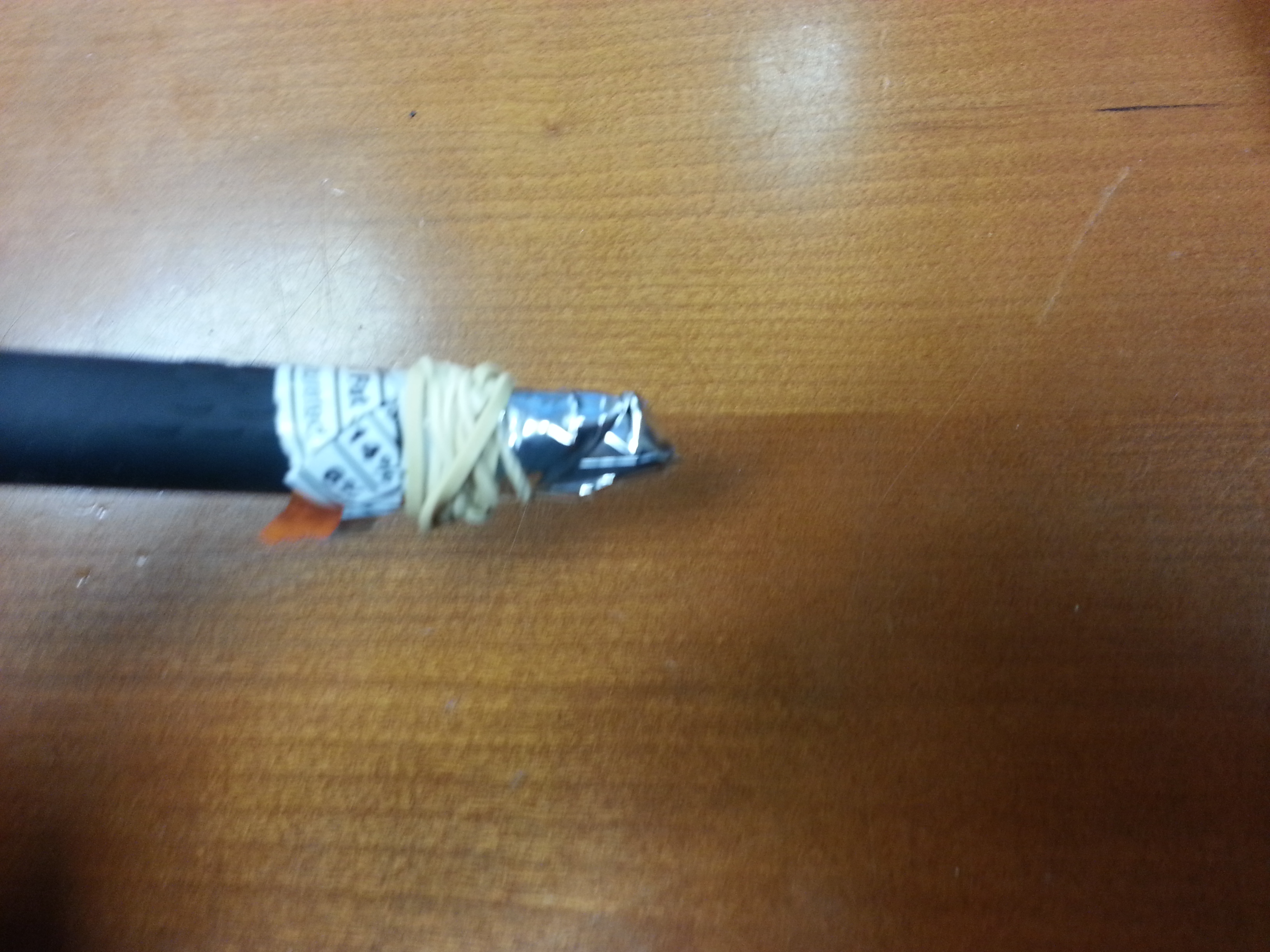 Picture of Take Rubber Band and Wrap It Around End of Pen Until Rubber Band Is Tight.
