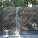 Screen a Chain Link Fence With Lath