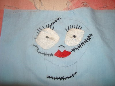 Embroider the Face and Torn Designs of the Doll