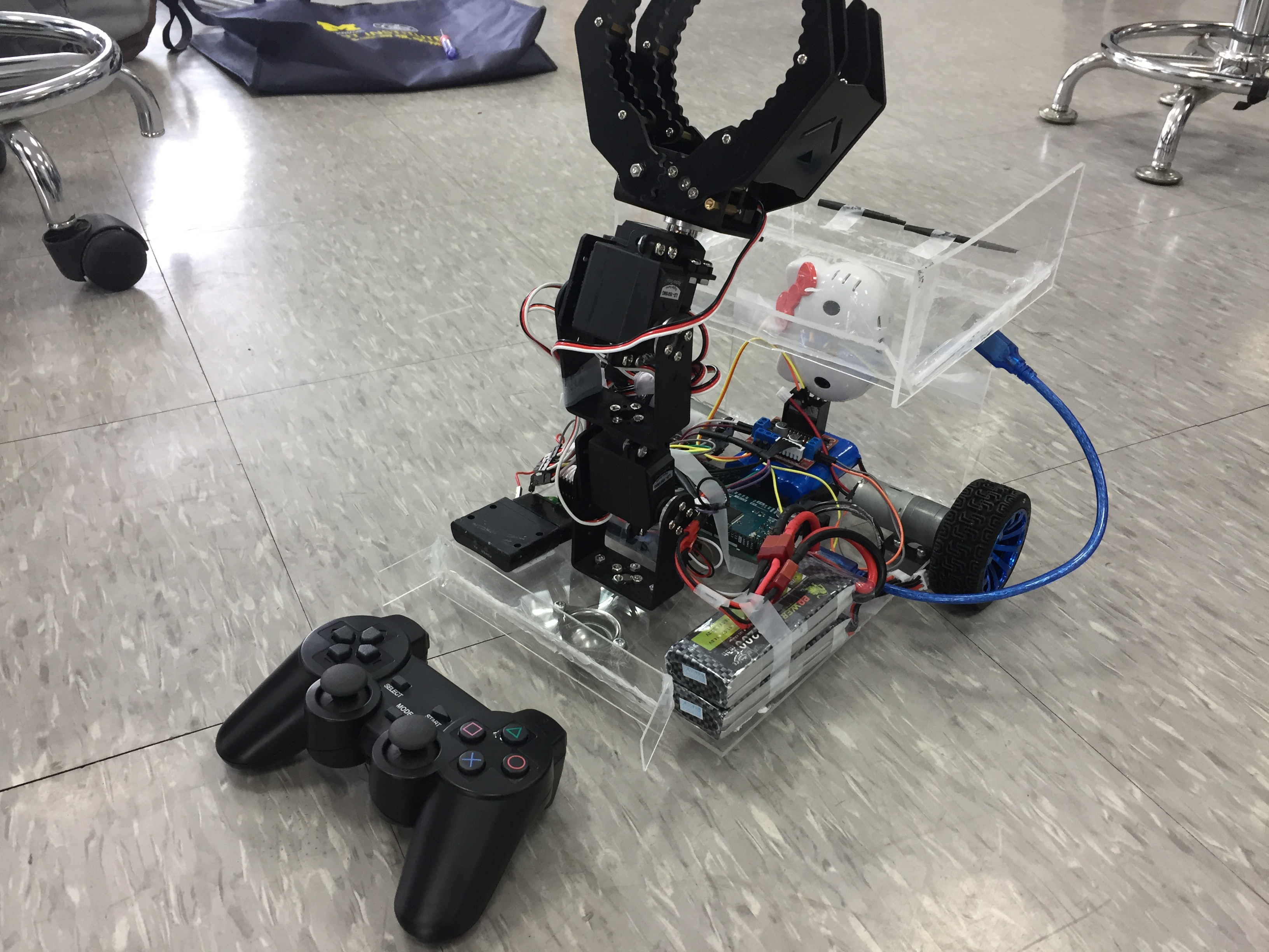 Picture of Naval Battle: a Robot Car Grabbing Balls to the Territory