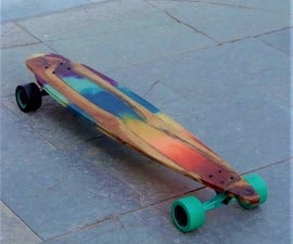 Rainbow Glow in the Dark Longboard Made With Wood and Epoxy