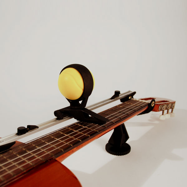 Picture of Guitar Aid for People With Limited Finger Agility.