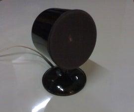 Spray paint caps for speaker enclosure