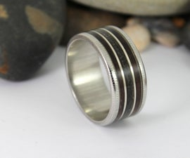 Damascus Steel Ring With a Real Megalodon Tooth