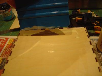 Gluing Veneers to the Box