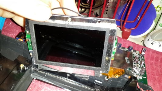 Remove Center Screw From Screen Assembly.