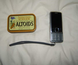 Solar Cell Phone Charger made from old parts and an...ALTOIDS TIN ... what else??