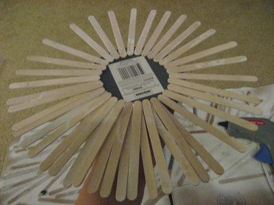 Flip Your Mirror Over, and Use the Hot Glue Gun to Adhere the Popsicle Sticks to the Back of the Mirror.