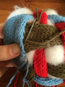 Stuffing and Stitching Up the Ball