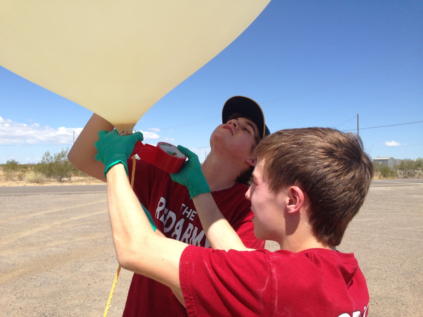 Picture of Attaching the Rope to the Cooler, Parachute and Balloon