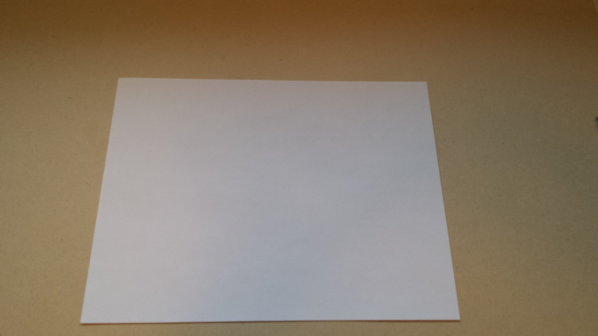 Picture of Turning a Rectangle Piece of Paper Into a Square