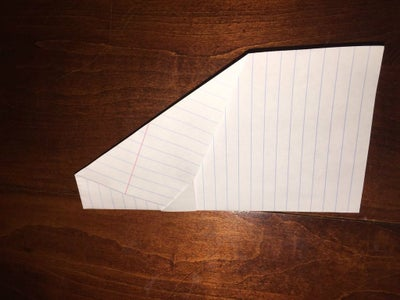 Fold the Airplane in Half at the Center Fold