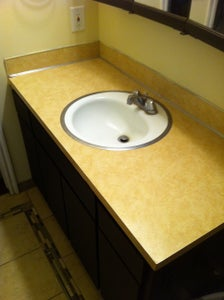 Hack an Inexpensive Granite Table Into a Bathroom Vanity