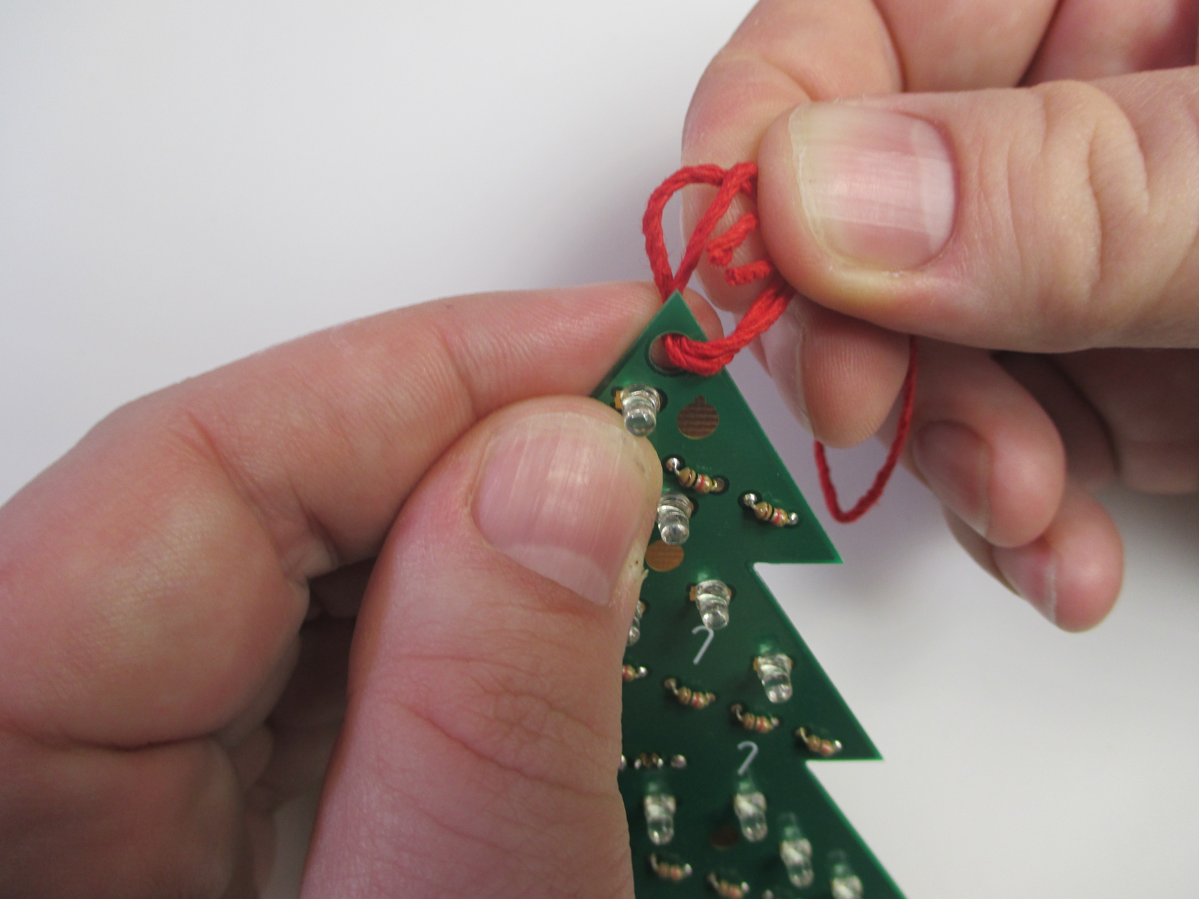 Picture of Tie the String Through the Hole in the Ornament