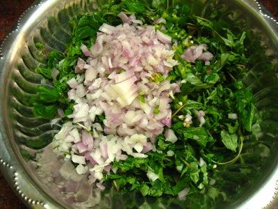 Mix Onion and Green Chillies With Amaranth Leaves