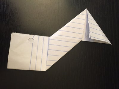Fold the Top and Bottom Squares of Both Pieces of Paper Inward for Make a Triangle.