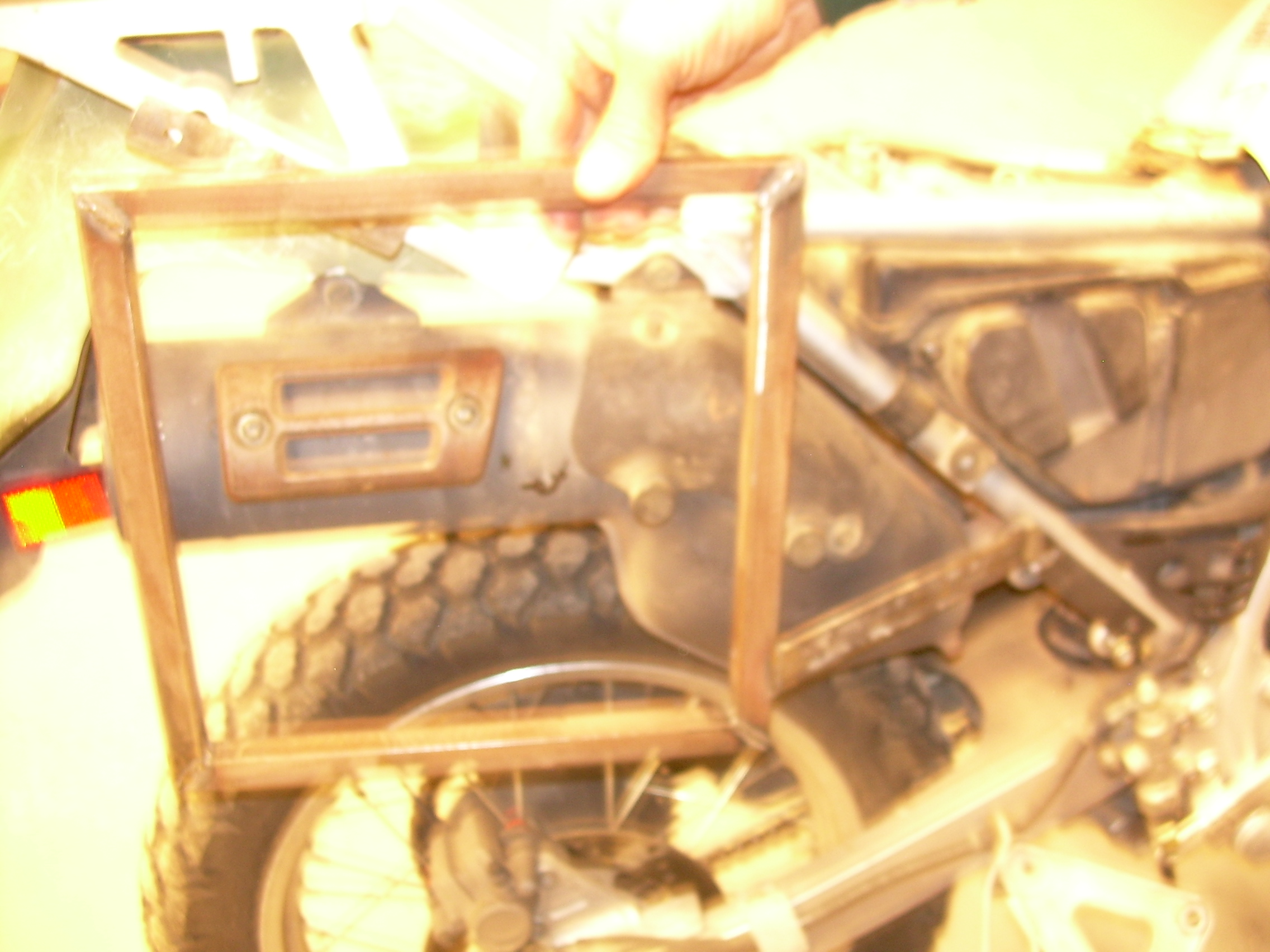 Picture of Motorcycle Panniers Made Out of Plastic Ammo Boxes