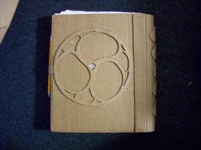 Rebinding a SketchBook Using Wasted Cardboard