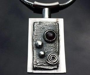 Silver Cuttlefish Cast W/ Garnet Pendant
