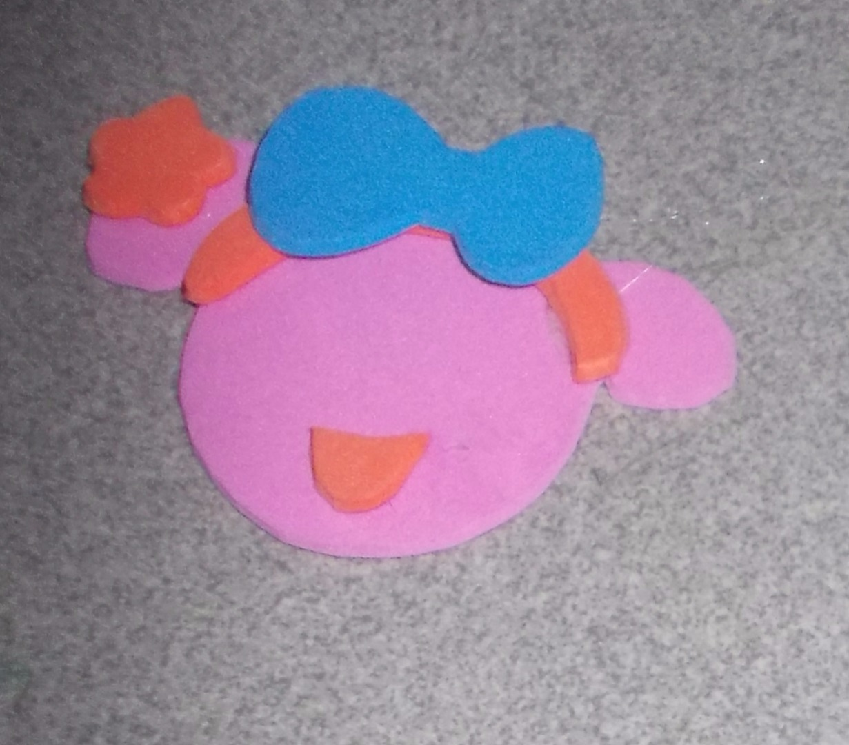 Picture of Cut the Blue Foam Bow. Glue the Bow Onto the Headband and the Flower Onto the Right Ear.