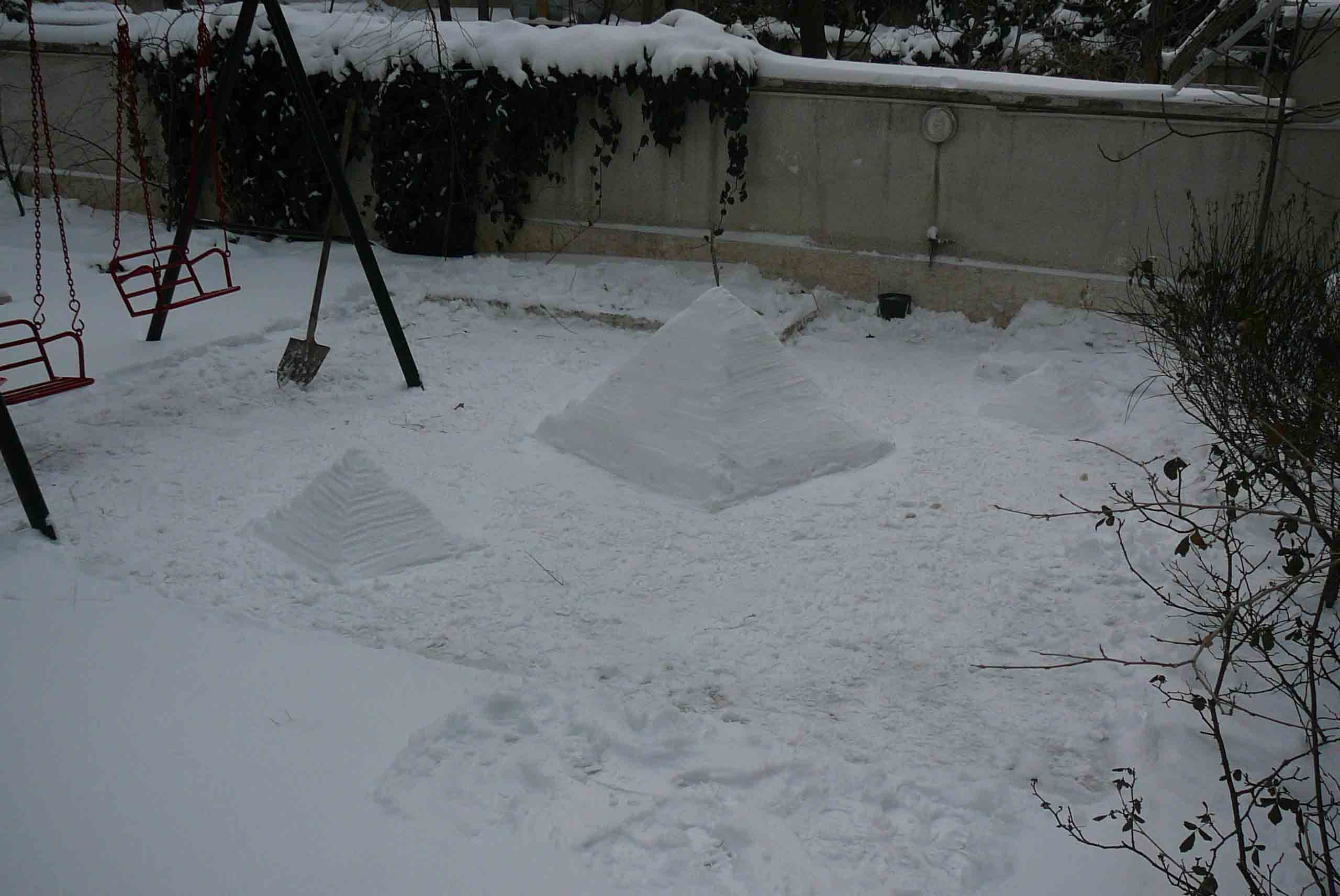 "Picture of Making the ""Pyramids of Giza"" Out of Snow"