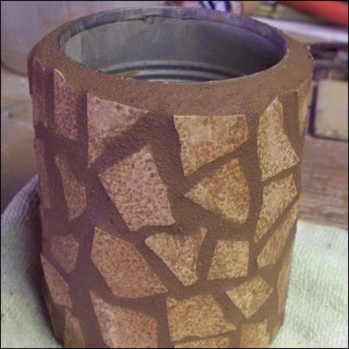 Picture of A Can With Broken Tile As a Mosaic