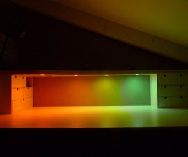 Raised desk shelf with multi coloured led