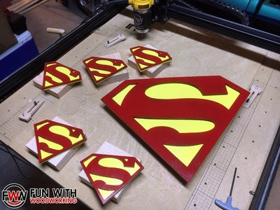 """Glue the Red """"S"""" on Top of the Backer Shield"""