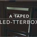 A Taped Led-tterbox