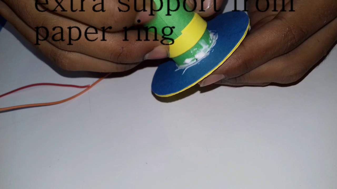 Picture of Soldering Wires to the Motor and Connecting Battery, Motor to the Base