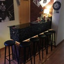 Make a 'home bar' from old Ikea furniture, wallpaper and imagination