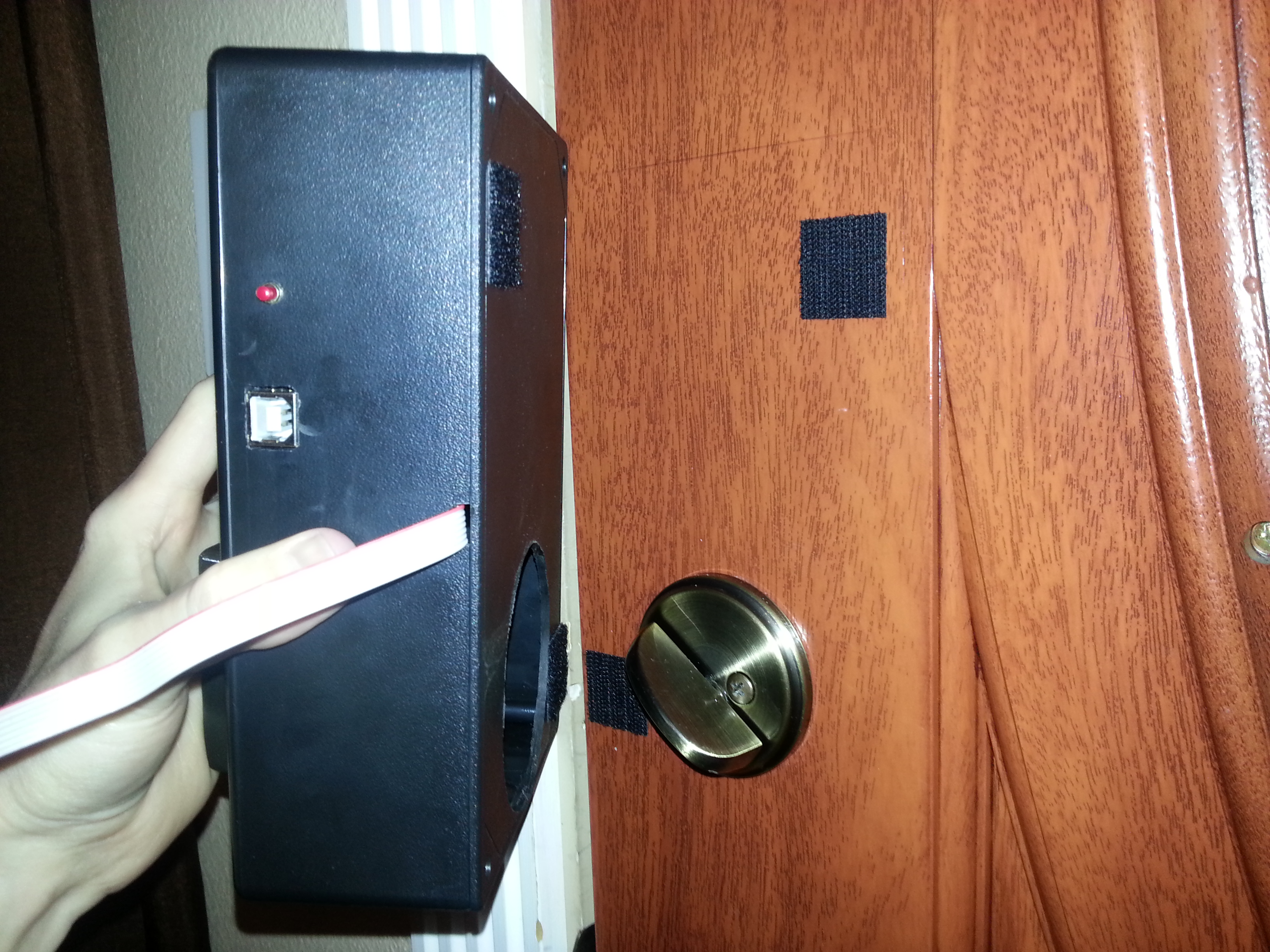 Picture of Mounting the Deadbolt Controller to the Door