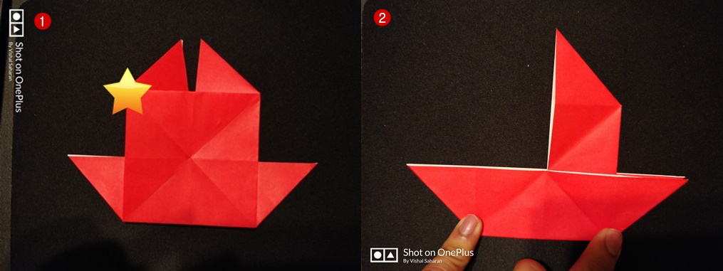 Picture of Fold the Top Left Corner Along the Diagonal Crease to Complete the Boat.
