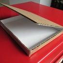 A Compact Disc (CD) Mailer Box