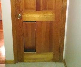 Hidden Pet Door in Panel Door