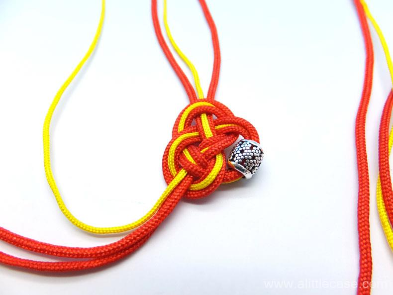 Picture of Braid a Heart Shape Double Coin Knot With the Cords.