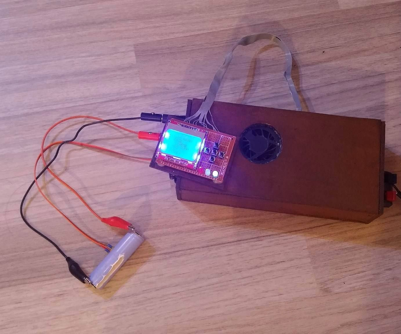 Nicd Charger With Current And Voltage Limiting