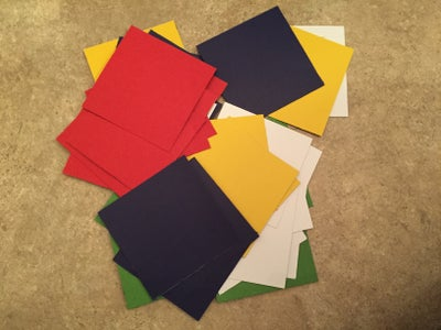 Cut Out Squares of Colored Paper and Glue.